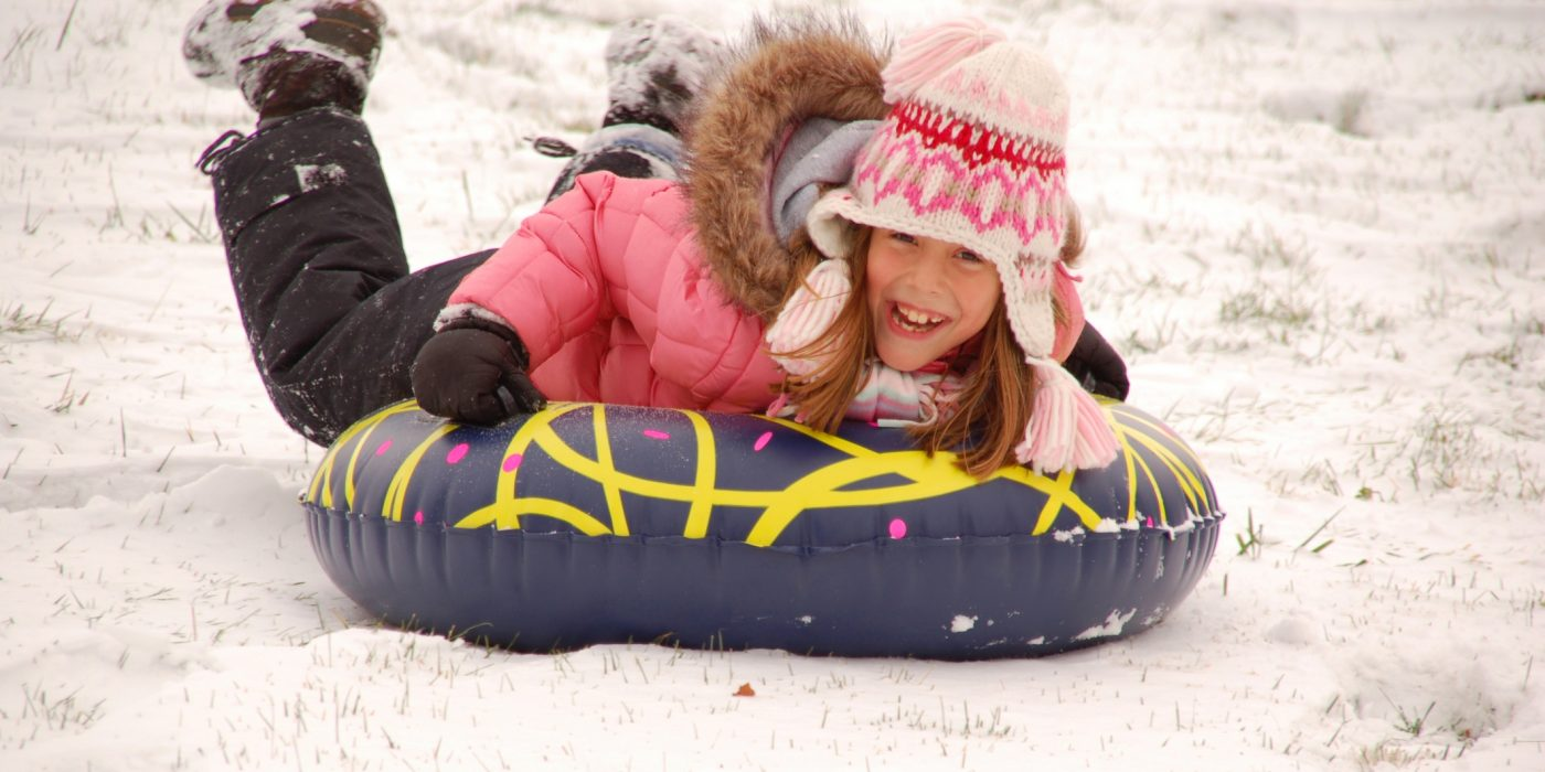 Girl Tubing on the Snow