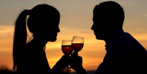 Couple Sipping Wine at Sunset
